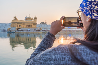 January 2018 - The Golden Temple in Amritsar, India. Bhav watches the sunset with the reflection of the Golden Temple in her sunglasses