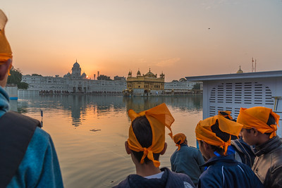 January 2018 - A group of young men watch the sunset at the Golden Temple - in Amritsar, India.
