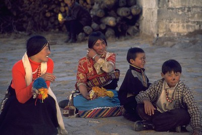 Pilgrims and their children with black ash blessing on their nose