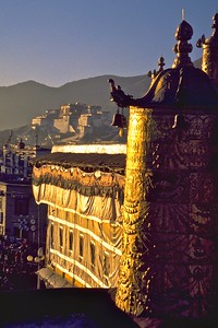 Prayer wheel bathed in the golden light of the afternoon on the roof of the Jokhang