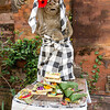 Bali Statue With Food Offerings