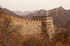 A guardtower stands at the end of an extension of the Great Wall of China at Mutiany in the Beijing province. In the background, the steep mountains provide an indication of the rugged terrain.