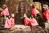 Stone foxes (kitsune), dressed with red capes, act as guardians to Japanese Shinto shrines. The foxes also act as messengers to Inari, the goddess of agriculture.