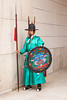 SEOUL, KOREA - APRIL 27, 2012: A guard in a teal green uniform stands at attention at the entrance to the Gyeongbokgung Palace complex in Seoul, Korea on April 27, 2012.