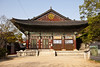 One of the  buildings at the Bongeunsa Buddhist temple in Seoul, South Korea. It's a traditional building made of wood and is highly decorated with bright paint colors.
