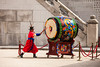 SEOUL, KOREA - APRIL 27, 2012: A guard is strking a giant ceremonial drum during the changing of the guard ceremony at the Gyeongbokgung Palace complex in Seoul, Korea on April 27, 2012.