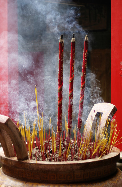 An urn in a Buddhist temple filled with incense and larger prayer sticks. This had so many prayer sticks in it because it was taken during the moon festival.