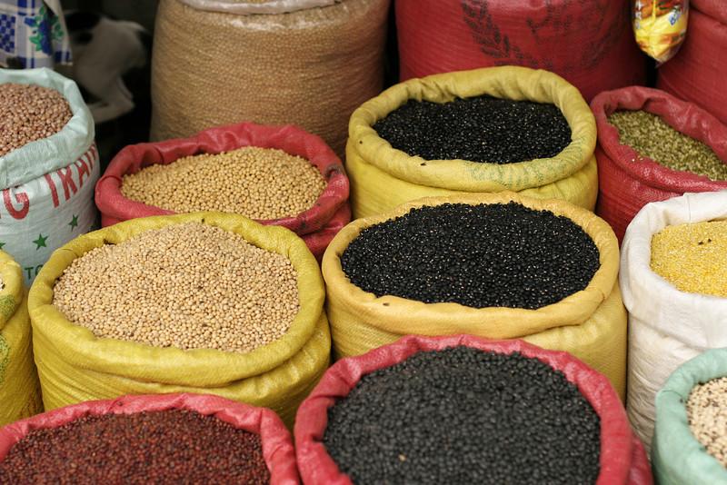 Bags of grain displayed at a street market in Vietnam.