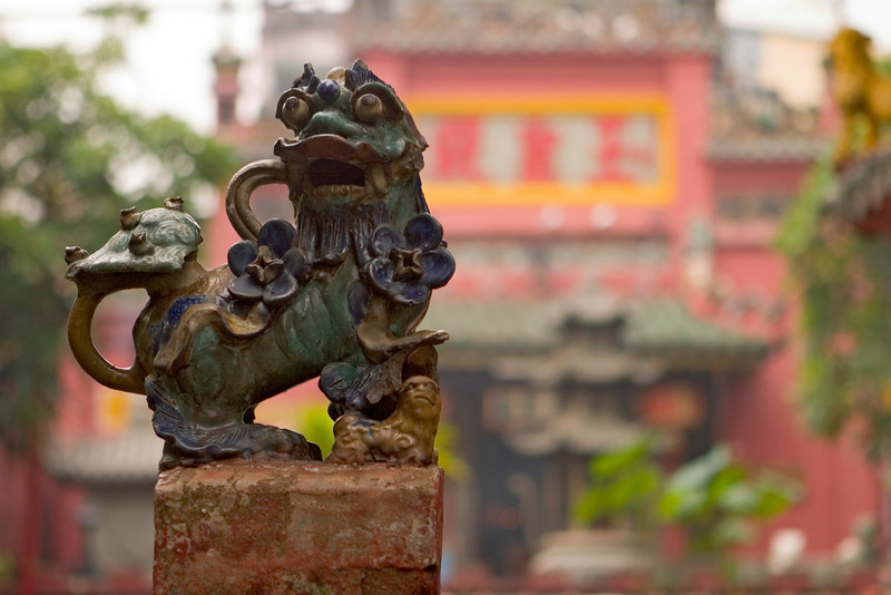 A Chinese lion guarding the front gate of a Buddhist temple in Ho Chi Minh City (Saigon) in Vietnam.
