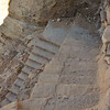 Steep stairs lead down from the Lion Monument on the Wadi Farasa trail.