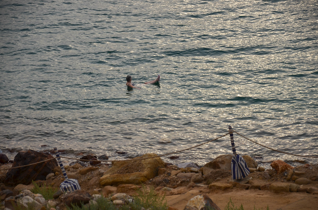 Woman floating in the Dead Sea.