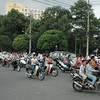 A typical Saigon street. Tons of motorbikes, mixed in with cars. try crossing this (people don't stop).