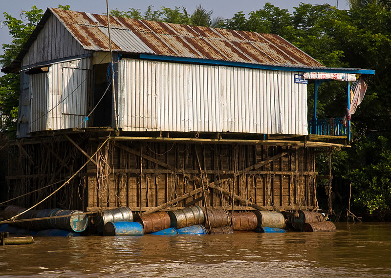 Many floating houses have fish pens below; this one has been raised up for repairs.