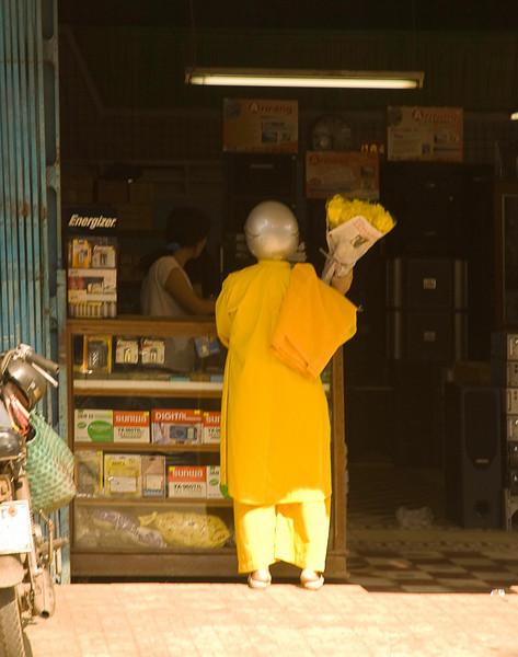 Motorcycle monk buying matching flowers
