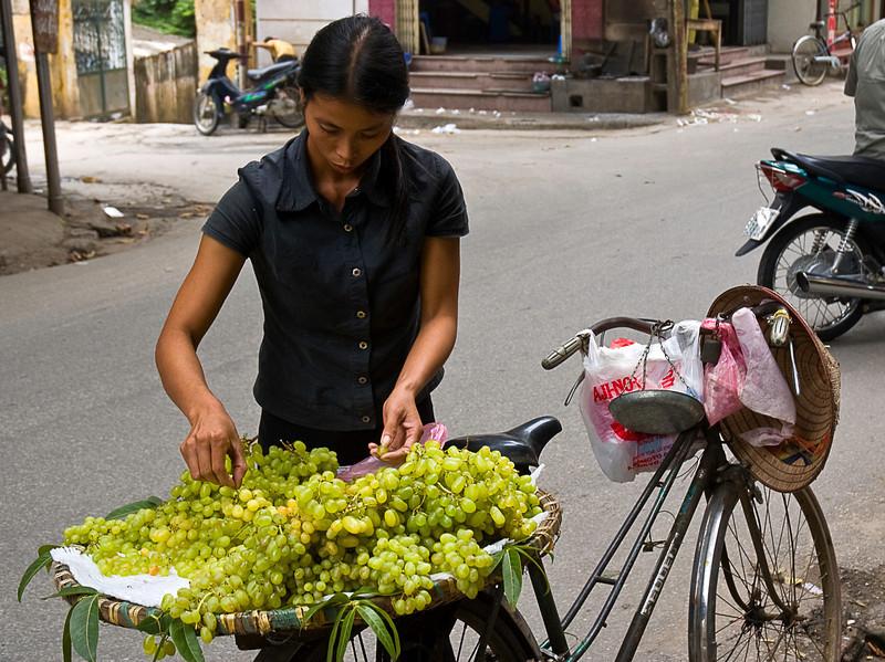 Grape vendor, Hanoi side street