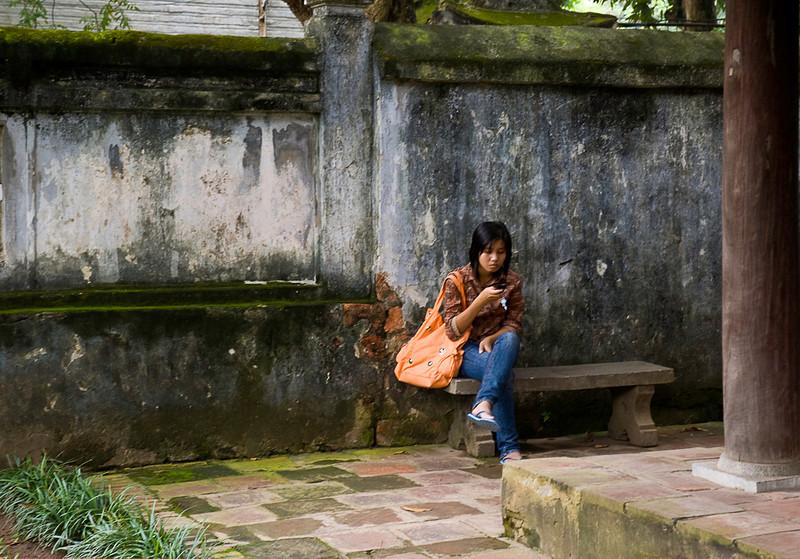 Texting in the Temple of Literature garden, Hanoi