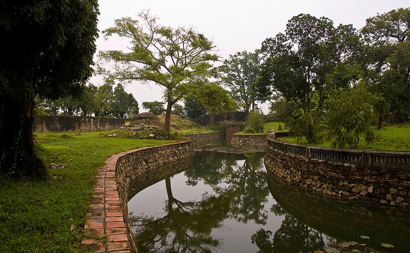 Gardens, moats and walkways surround elaborate ceremonial buildings.