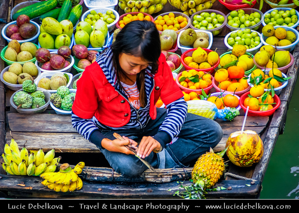 Vietnam - Floating Village and Floating Market in Ha Long Bay - Vịnh Hạ Long - Descending Dragon Bay - UNESCO World Heritage site - located in Quảng Ninh province - Traditional Fruit market on the boat