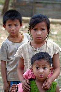 Disgruntled children in Laos village on Mekong River