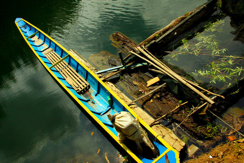 Longboat and Fish Farm - Borneo