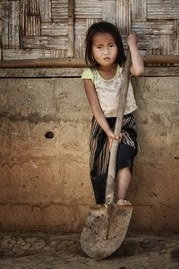 Young tribal girl in village along Mekong River in Laos
