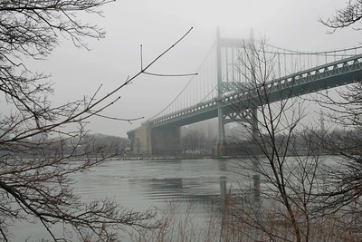 View of the RFK Bridge (Triboro Bridge) in a foggy day, from Astoria Park New York