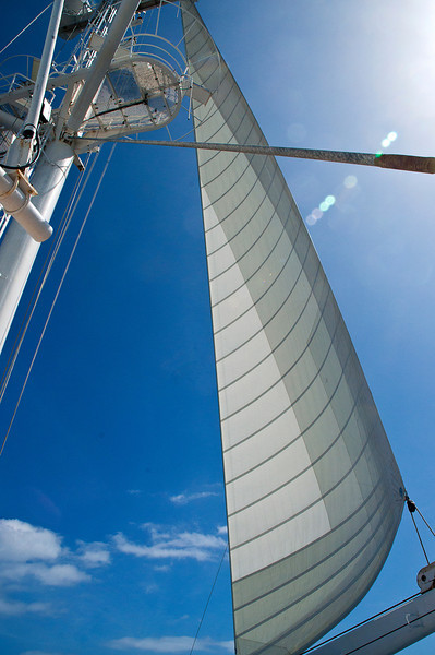 Foresail on another tack with sun-deviled lens flare