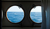 Cabin porthole view in moderate seas