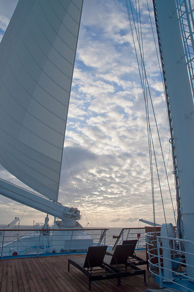 Sunrise with scattered clouds and the foresail grown big-bellied with the wanton wind as the Moor of Venice once said.