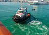 Cycloidal-powered tug pulls MSY Wind Surf off the pier; she could have moved laterally herself with bow thrusters, the main engines and hard port rudder.  <br /> <br /> We saw that done.