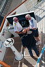 Captain and First Mate with Civitavecchia Harbor Pilot on the port wing con.