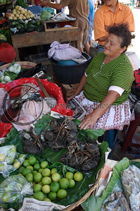A typical market day in the Mercado de Ataco. Notice the fresh crab (cangrejos) tied up in bundles just above the limes. How appropriate! If you don't know Concepcion de Ataco, Ahuachapan, El Salvador. Concepcion de Ataco, El Salvador.