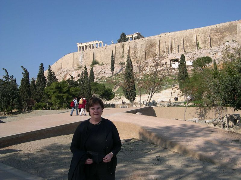Susan in front of the Acropolis near the Theater of Dionysos.  The Parthenon is just visible on the Acropolis.