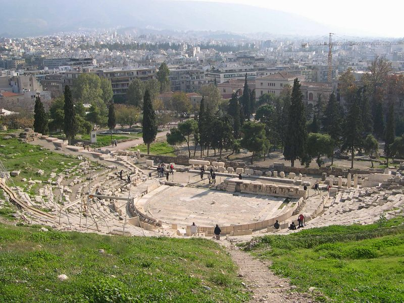 Theater of Dionysos, with modern Athens in the background.