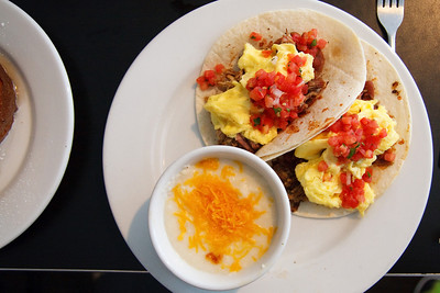 Pulled Pork Breakfast Tacos Two flour tortillas with drunken beans,  eggs, hickory smoked pork and pico de  gallo served with cheese grits 7.99