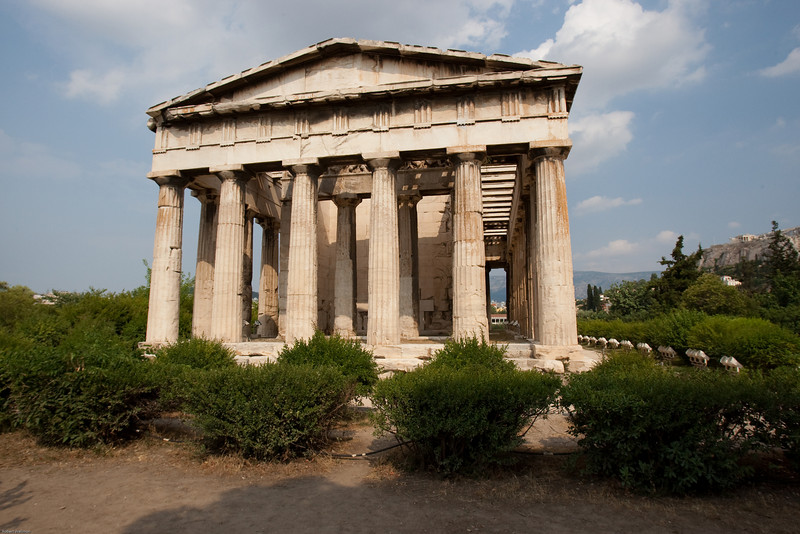 4M9F4898-18 Temple of Hephaestus was built around 449 BC on the western edge of the city. Hephaestus was the god of blacksmiths and metallurgy. Built from marble, the temple is an example of the Doric style and is much more well preserved than the more famous Pathenon which is barely visible in the background.