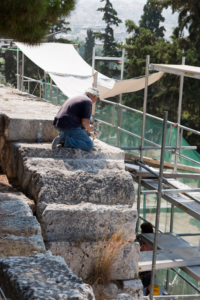 4M9F4996-35 Worker shown restoring the stoa of Eumenes which is located between the Theatre of Dionysos and the Odeion of Herodes Atticus, along the Peripatos, the ancient road around the Acropolis.