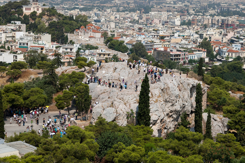 4M9F5008-1 Tourist flock to Areopagus Hill in part because of its wonderful view of the city. Areopagus Hill or Hill of Ares, located just above the Ancient Agora, is composed of bare marble and provides a wonderful view of the city.  Historically, it is popular with tourists for its connections with a speech made by Paul the Apostle. The site was at one time a homicide court and once a meeting place for the city elders.