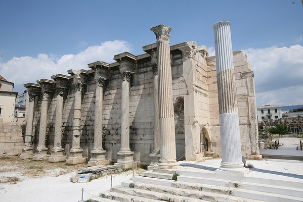 "Hadrian's Library, Athens, Greece<br /> <br /> Hadrian's Library was created by Roman Emperor Hadrian in AD 132 on the north side of the Acropolis of Athens. The building followed a typical Roman Forum architectural style, having only one entrance with a propylon of Corinthian order, a high surrounding wall with protruding niches (oikoi,exedrae) at its long sides, an inner courtyard surrounded by columns and a decorative oblong pool in the middle. The library was on the eastern side where rolls of papyrus ""books"" were kept. Adjoining halls were used as reading rooms, and the corners served as lecture halls."