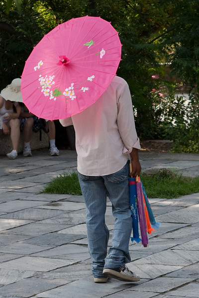 4M9F4929-25 Immigrant selling umbrellas outside the entrance to Acropolis.