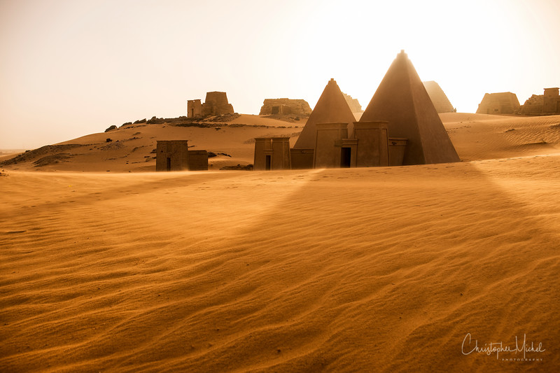 The sun sets over the pyramids of Meroë.