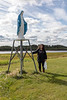 Denise Lantz with statue of Mary at St. Francis Xavier Roman Catholic Church in Attawapiskat. 2018 September 5.