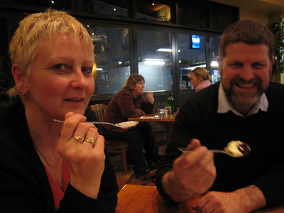 Rae and Brad discussing the possible downside of sharing one dessert between three.