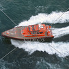 Pilot boat cruising along side the ship in Auckland, New Zealand.