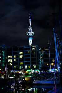 The skytower is lit up over Auckland's Viaduct Harbour during the Volvo Ocean Race stopover 2012