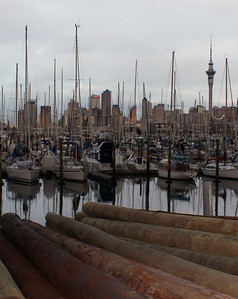 Mooring Piles sit on the dockside at Westhaven Marina In Auckland, New Zealand.