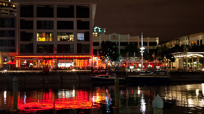 Lights reflect in the water of the Auckland Viaduct during the Volvo Ocean Race stopover 2012