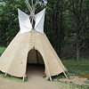 ...a traditional Lakota teepee set up at the base for all to see...