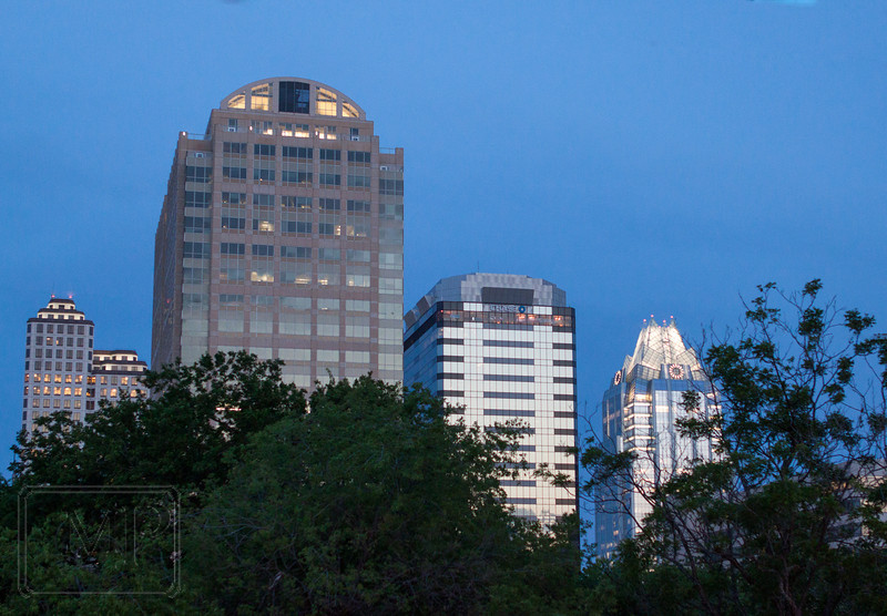 Dusk in the Downtown - A few tal buildings stand out over the trees.  Seen from the deck at the Rattle Inn.
