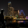 Downtown Austin at night - Statue of SRV against the city lights and reflections.